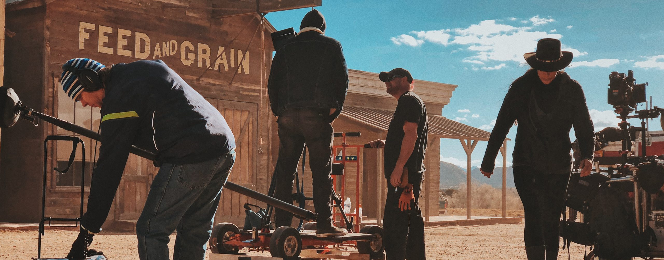 film crew with equipment in front of an old western building